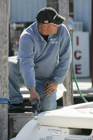 Mike Greene - mgreene@shawmedia.com Scott Gaylor, service manager at Chain O' Lakes Marina, refuels a boat on the marina Tuesday, April 17, 2012 in Fox Lake. Increased gas prices are causing consumers to use smaller boats and find ways to save money at the gas pump.