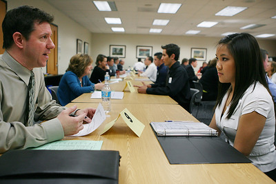 Mike Greene - mgreene@shawmedia.com John Voelz, physical therapist at Northwest Senior Wellness, speaks with Huntley High School senior Juli Domingo during a mock interview Tuesday, April 17, 2012 at the Huntley District 158 office in Algonquin. Students from Huntley High School's co-op program interviewed with over 20 individuals from local business to gain experience with the hiring process.