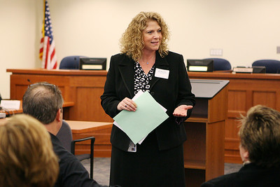 Mike Greene - mgreene@shawmedia.com Mary Graft, director of the Cooperative Education Program at Huntley High School, speaks with individuals from local businesses prior to the start of mock interviews Tuesday, April 17, 2012 at the Huntley District 158 office in Algonquin. Graft spoke with the group about what she wanted to see from the event.