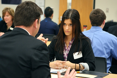 Mike Greene - mgreene@shawmedia.com Huntley High School senior Karli Cervantes (cq) listens to Joel Bosman, District 158 campus  supervisor, during a mock interview Tuesday, April 17, 2012 at the Huntley District 158 office in Algonquin. The down economy has placed a greater emphasis on being well prepared for the job market.