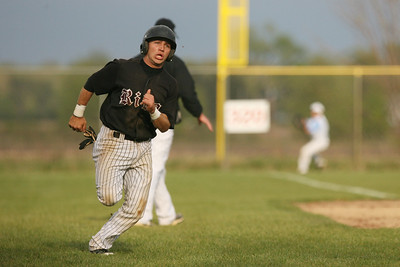 Mike Greene - mgreene@shawmedia.com Prairie Ridge's Kyle Kwiatkowski (cq) runs home during a game Wednesday, April 18, 2012 in Woodstock. Marian Central won the gam 7-6.