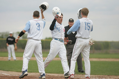 Mike Greene - mgreene@shawmedia.com Marian Central's Lincoln Herendeen celebrates with teammates after hitting a three-run home run during a game against Prairie Ridge Wednesday, April 18, 2012 in Woodstock. Marian Central won the gam 7-6.