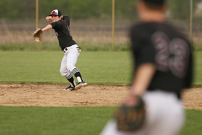 Mike Greene - mgreene@shawmedia.com Prairie Ridge's Kyle Hodorowicz loads while throwing to first base during a game against Marian Central Wednesday, April 18, 2012 in Woodstock. Marian Central won the game 7-6.