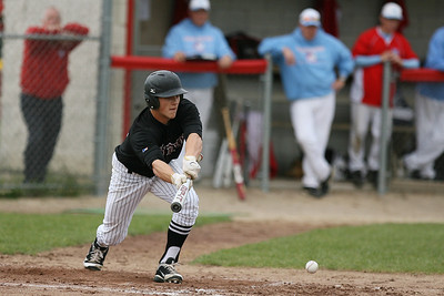 Mike Greene - mgreene@shawmedia.com Prairie Ridge's Jordan Getzelman lays down a bunt during a game against Marian Central Wednesday, April 18, 2012 in Woodstock. Marian Central won the gam 7-6.