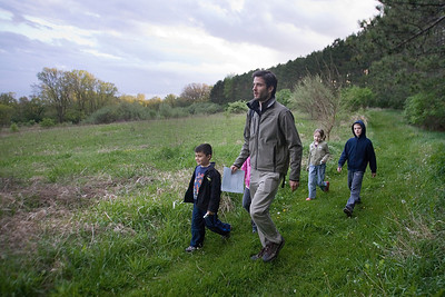 Mike Greene - mgreene@shawmedia.com Brian Carroll walks leads a group of children through a nature treasure hunt held by the McHenry County Conservation District Wednesday, April 18, 2012 in Woodstock. The event included clues to find hidden treasures, while learning about the importance of plants and animals