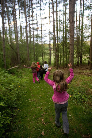 Mike Greene - mgreene@shawmedia.com Sara Willis, 5, points in the air while walking down a path during a nature treasure hunt held by the McHenry County Conservation District Wednesday, April 18, 2012 in Woodstock. The event included clues to find hidden treasures, while learning about the importance of plants and animals