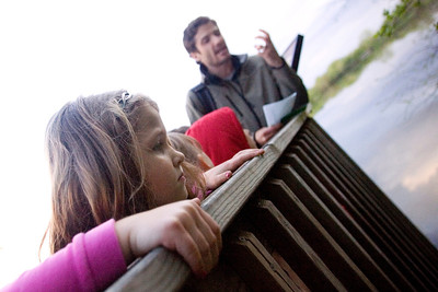 Mike Greene - mgreene@shawmedia.com Sara Willis, 5, looks over the side of a dock during a nature treasure hunt held by the McHenry County Conservation District Wednesday, April 18, 2012 in Woodstock.
