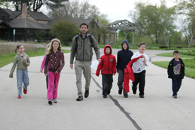 Mike Greene - mgreene@shawmedia.com McHenry County Conservation District education program assistant Brian Carroll (cq) leads a group of children during a nature treasure hunt held Wednesday, April 18, 2012 in Woodstock. The event included clues to find hidden treasures, while learning about the importance of plants and animals