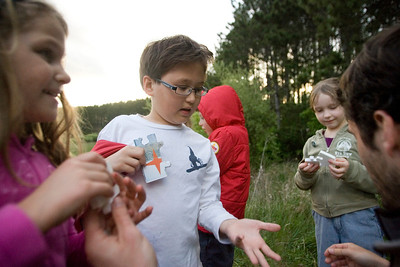 Mike Greene - mgreene@shawmedia.com Joseph Anderson, 10, holds his hand out for a puzzle piece as part of a nature treasure hunt held by the McHenry County Conservation District Wednesday, April 18, 2012 in Woodstock. The McHenry County Conservation District is one of many organizations that offer opportunities for children to learn and be active during the summer.