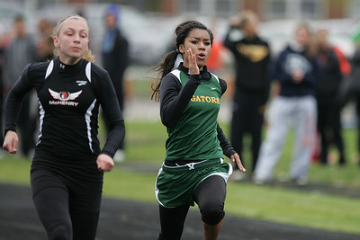 Mike Greene - mgreene@shawmedia.com Crystal Lake South's Lana Summers runs in the fourth heat of the girls 100 meter dash semi-finals during the McHenry County Track & Field Meet Thursday, April 19, 2012 in Crystal Lake.