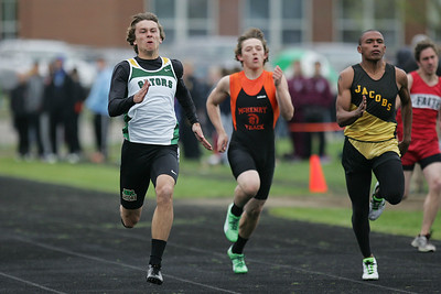 Mike Greene - mgreene@shawmedia.com Crystal Lake South's Zane Boettcher runs in front of the pack in the first heat of the boys 100 meter dash semi-finals during the McHenry County Track & Field Meet Thursday, April 19, 2012 in Crystal Lake.
