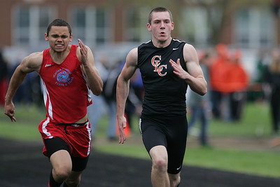 Mike Greene - mgreene@shawmedia.com Marian Central's Jordan Niemeyer (left) chases Crystal Lake Central's Isaiah Mosher in the third heat of the boys 100 meter dash semi-finals during the McHenry County Track & Field Meet Thursday, April 19, 2012 in Crystal Lake.