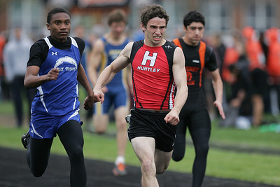 Mike Greene - mgreene@shawmedia.com Woodstock's JerPatrick Cosper (left) races against Huntley's Ryan Tharp in the fourth heat of the boys 100 meter dash semi-finals during the McHenry County Track & Field Meet Thursday, April 19, 2012 in Crystal Lake.