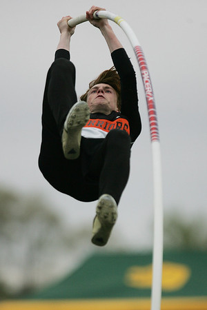 Mike Greene - mgreene@shawmedia.com McHenry's Nate Richartz goes airbourne while competing in the pole vault event during the McHenry County Track & Field Meet Thursday, April 19, 2012 in Crystal Lake. Richartz took first place in the event.
