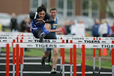 Mike Greene - mgreene@shawmedia.com Woodstock's Tyler Parsons jumps while racing in the first heat of the boys 110 meter high hurdles semi-finals during the McHenry County Track & Field Meet Thursday, April 19, 2012 in Crystal Lake.