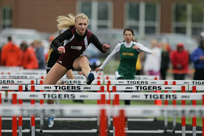 Mike Greene - mgreene@shawmedia.com Marengo's Allison Rogutich breaks away from the group while competing in the fourth heat of the girls 100 meter hurdles during the McHenry County Track & Field Meet Thursday, April 19, 2012 in Crystal Lake.