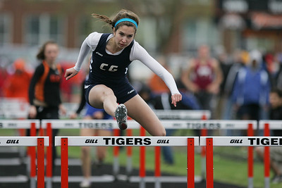Mike Greene - mgreene@shawmedia.com Cary-Grove's Kathie Wollney races ahead of the group in the first heat of the girls 100 meter hurdles semi-finals during the McHenry County Track & Field Meet Thursday, April 19, 2012 in Crystal Lake.