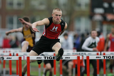 Mike Greene - mgreene@shawmedia.com Huntley's Jake Brock jumps over a hurdle in the fourth heat of the boys 110 meter high hurdles semi-finals during the McHenry County Track & Field Meet Thursday, April 19, 2012 in Crystal Lake.
