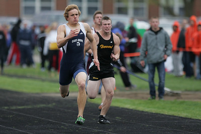 Mike Greene - mgreene@shawmedia.com Cary-Grove's Tommy Rohn races in the third heat of the boys 100 meter dash semi-finals during the McHenry County Track & Field Meet Thursday, April 19, 2012 in Crystal Lake.
