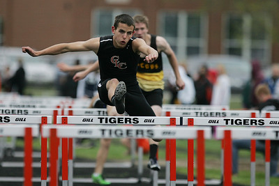 Mike Greene - mgreene@shawmedia.com Crystal Lake Central's Robert Ferris jumps over a hurdle in the boys 110 meter high hurdles semi-finals during the McHenry County Track & Field Meet Thursday, April 19, 2012 in Crystal Lake.