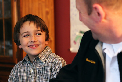 Mike Greene - mgreene@shawmedia.com Zack, 6, smiles while speaking with his 'Big Brother' Gene Lowery Thursday, April 19, 2012 in Crystal Lake. This was Zack's first time speaking with his 'Big Brother' and the pair made plans to go bowling and play catch together.