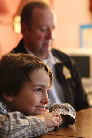 Mike Greene - mgreene@shawmedia.com Zack, 6, smiles during his first meeting with his 'Big Brother' Gene Lowery Thursday, April 19, 2012 in Crystal Lake. The pair made plans to go bowling and play catch together.
