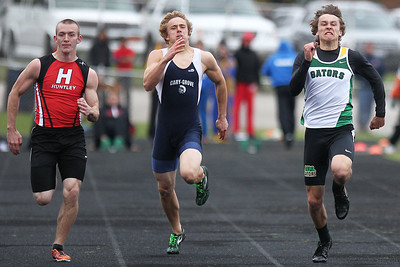 Mike Greene - mgreene@shawmedia.com Huntley's James Davis, Cary-Groves Tommy Rohn, and Crystal Lake South's Zane Boettcher compete in the boys 100 meter dash finals during the McHenry County Track & Field Meet Friday, April 20, 2012 in Crystal Lake. Crystal Lake South's Zane Boettcher took first place in the event.