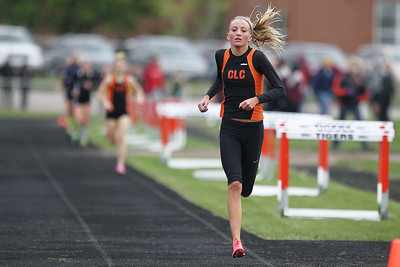 Mike Greene - mgreene@shawmedia.com Crystal Lake Central's Sammi Staples runs in front of the group while competing in the girls 3200 meter run finals during the McHenry County Track & Field Meet Friday, April 20, 2012 in Crystal Lake. Staples took first place in the event.