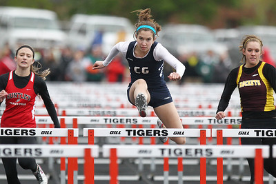Mike Greene - mgreene@shawmedia.com Cary-Grove's Kathie Wollney jumps over a hurdle in the girls 100 meter hurdles finals during the McHenry County Track & Field Meet Friday, April 20, 2012 in Crystal Lake.