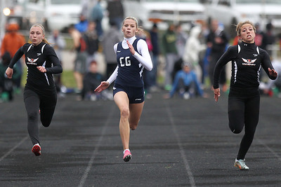 Mike Greene - mgreene@shawmedia.com Cary-Grove's Sarah Ryan (center) races in the girls 100 meter dash final during the McHenry County Track & Field Meet Friday, April 20, 2012 in Crystal Lake. Ryan took first place in the event.
