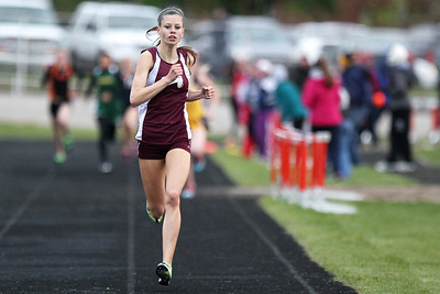 Mike Greene - mgreene@shawmedia.com Marengo's Allie Sprague runs in front of the group in the girls 800 meter final during the McHenry County Track & Field Meet Friday, April 20, 2012 in Crystal Lake. Sprague took first place in the event.