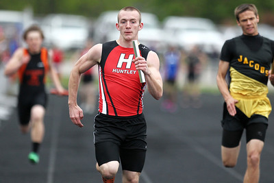 Mike Greene - mgreene@shawmedia.com Huntley's James Davis runs the last leg of the boys 4x100 meter relay final during the McHenry County Track & Field Meet Friday, April 20, 2012 in Crystal Lake.