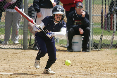 Mike Greene - mgreene@shawmedia.com Cary-Grove's Amy Clemment begins to run after laying down a bunt against Belvidere North during the Woodstock Softball Invitational Saturday, April 21, 2012 in Woodstock. Cary-Grove won the game 13-5.