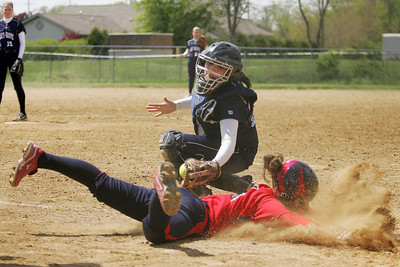 Mike Greene - mgreene@shawmedia.com Cary-Grove's Sarah Leudo attempts to tag Belvidere North's Hannah Tauscher during a game in the Woodstock Softball Invitational Saturday, April 21, 2012 in Woodstock. Tauscher was safe on the play, but Cary-Grove won the game 13-5.