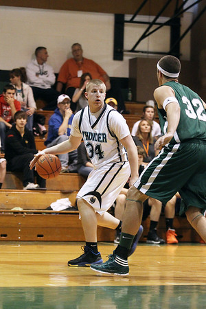 Mike Greene - mgreene@shawmedia.com Woodstock North's Zach Devore dribbles while being guarded by Grayslake Central's Casey Boyle during the McHenry County Area Boys All-Star game Sunday, April 22, 2012 in Hebron. Devore and the home team won the game 90-85 with Huntley's Justin Frederick being named MVP for the game.