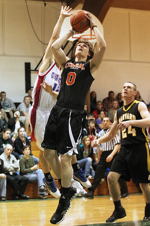 Mike Greene - mgreene@shawmedia.com Crystal Lake Central's Nick DeCoster takes a shot near the basket during the McHenry County Area Boys All-Star game Sunday, April 22, 2012 in Hebron.