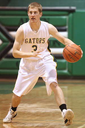Mike Greene - mgreene@shawmedia.com Crystal Lake South's Will Ahsmann dribbles the ball down the court during the McHenry County Area Boys All-Star game Sunday, April 22, 2012 in Hebron.