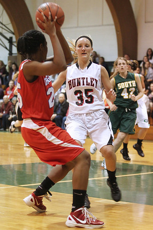 Mike Greene - mgreene@shawmedia.com Huntley's Abbey Shaw (right) defends Dundee-Crown's Diamond Williams during the McHenry County Area Girls All-Star game Sunday, April 22, 2012 in Hebron.