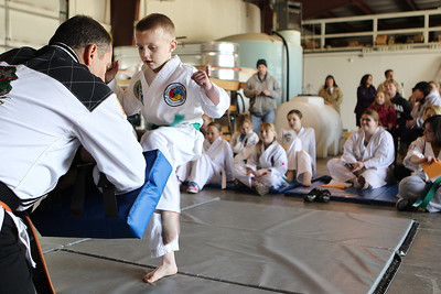 "Mike Greene - mgreene@shawmedia.com Conor Benz, 6, of the Spring Grove Flying Dragons martial arts school kicks a pad during a fundraiser for the Spring Grove Police Department Sunday, April 22, 2012 in Spring Grove. The fundraiser, which involved tallying the number of kicks an individual could do in one minute, was held to raise funds for the police department's newly obtained K-9 Unit. The event raised $2,654.75 for the department and will go towards a protective vest, equipment, training and other things needed for the department's K-9, ""Hunter."""