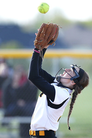 Mike Greene - mgreene@shawmedia.com Jacobs' Katie Kirker catches a pop-up near the mound while playing a game against Dundee-Crown Monday, April 23, 2012 in Algonquin. Jacobs won the game 7-2.