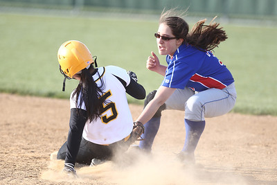 Mike Greene - mgreene@shawmedia.com Dundee-Crown's Lauren Mercado tags Jacobs' Nicky Chapa while attempting to steal second base Monday, April 23, 2012 in Algonquin. Chapa was safe on the play and Jacobs won the game 7-2.