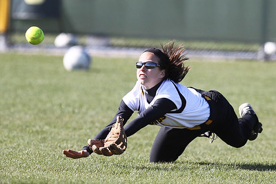 Mike Greene - mgreene@shawmedia.com Jacobs' Taylor Belo dives for a ball during a game against Dundee-Crown Monday, April 23, 2012 in Algonquin. Jacobs won the game 7-2.
