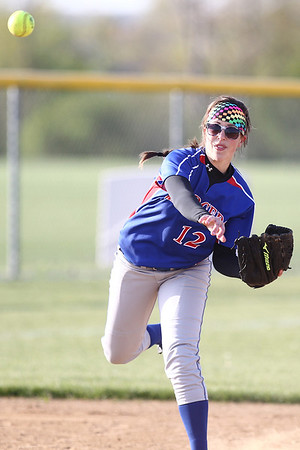 Mike Greene - mgreene@shawmedia.com Dundee-Crown's Lauren Lococo throws to first base while playing a game against Jacobs Monday, April 23, 2012 in Algonquin. Jacobs won the game 7-2.