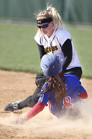Mike Greene - mgreene@shawmedia.com Jacobs' Maggie Hanson places a tag on Dundee-Crown's Lauren Girard Monday, April 23, 2012 in Algonquin. Jacobs won the game 7-2.