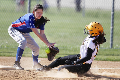 Mike Greene - mgreene@shawmedia.com Dundee-Crown's Mallory Schilf attempts to tag Jacobs' Courtney Cotugno during a play at third base Monday, April 23, 2012 in Algonquin. Cotugno was safe on the play and Jacobs defeated Dundee-Crown 7-2.