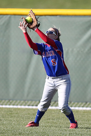 Mike Greene - mgreene@shawmedia.com Dundee-Crown's Lauren Girard catches a fly ball in center field whil playing a game against Jacobs Monday, April 23, 2012 in Algonquin. Jacobs won the game 7-2.