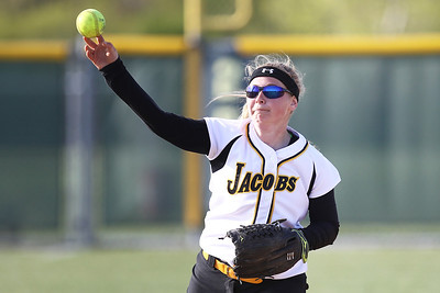 Mike Greene - mgreene@shawmedia.com Jacobs' Maggie Hanson throws towards first base while playing a game against Dundee-Crown Monday, April 23, 2012 in Algonquin. Jacobs won the game 7-2.