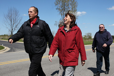 Mike Greene - mgreene@shawmedia.com David Good (left), Jackie Wagner, and Joe Foreman walk as part of a Medcor wellness program Monday, April 23, 2012 in McHenry. Medcor started a company-wide wellness program in January where employees can challenge one another with walking goals and other activities.