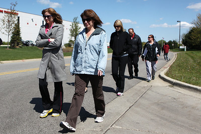 Mike Greene - mgreene@shawmedia.com Medcor Wellness program manager Heather Klaus (left) and Sarah Humpa walk with a group of co-workers as part of a walking program Monday, April 23, 2012 in McHenry. Medcor's Wellness program offers participants pedometers to keep track of how much they walk in an effort to promote healthy living.