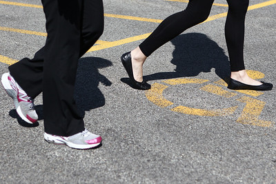 Mike Greene - mgreene@shawmedia.com Kristy Kolar (left) and Marlena Wagner walk as part of a Medcor wellness program Monday, April 23, 2012 in McHenry. Medcor's Wellness program offers participants pedometers to keep track of how much they walk in an effort to promote healthy living.